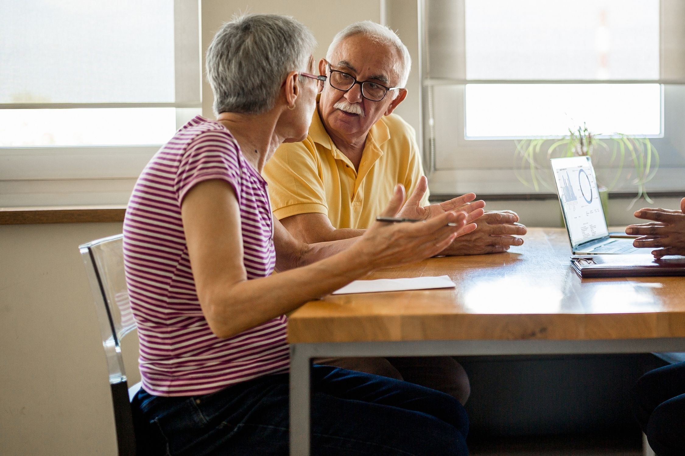 An older couple arguing in a therapy session in Rogers, MN